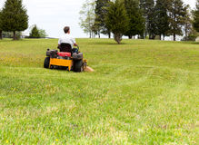 Senior man on zero turn lawn mower on turf Royalty Free Stock Photos
