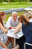 Senior manager with business team in meeting Royalty Free Stock Photos