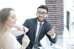 Senior manager and employee discussing financial documents Stock Images