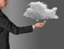 Senior manager with floating cloud computing royalty free stock image