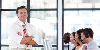 Senior manager with folded arms in a call center Royalty Free Stock Photos