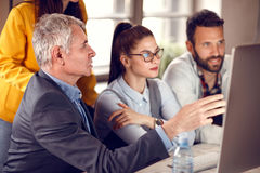 Senior manager gives suggestion to business team. Senior manager gives suggestion to young business team Royalty Free Stock Image