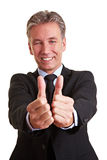 Senior manager holding both thumbs. Happy elderly business man holding both his thumbs up royalty free stock photo