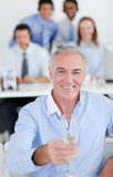 Senior manager holding a glass of Champagne Royalty Free Stock Image