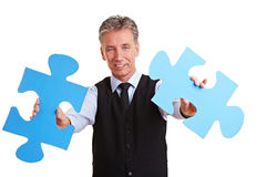 Senior manager holding jigsaw Stock Photography