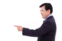 Senior manager, middle age businessman pointing to blank space royalty free stock images