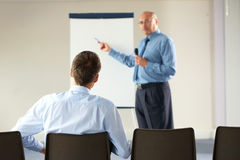 Senior manager during presentation Stock Image