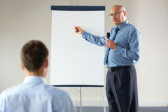 Senior manager during presentation, point to board Stock Image