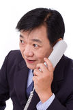 Senior manager receiving good news via telephone call Royalty Free Stock Photography