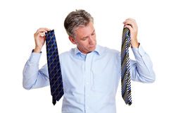Senior manager selecting a tie Royalty Free Stock Photo