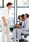 Senior manager talking to a worker in a call cente Stock Photo