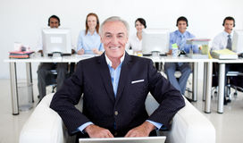 Senior manager using a laptop Royalty Free Stock Image