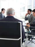 Senior manager viewed from behind in a meeting Stock Photos