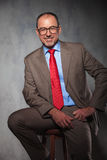 Senior manager wearing glasses posing seated Stock Photo