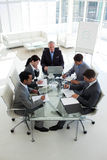 Senior manager working with his team at a computer Royalty Free Stock Photography