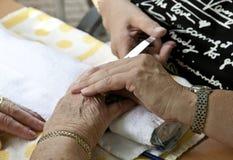 Senior Manicure Royalty Free Stock Photo