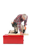 Senior manual worker sawing Royalty Free Stock Photos