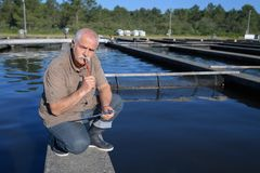 Senior manual worker standing working in water treatment plant Royalty Free Stock Photography