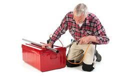 Senior manual workersolder metal Royalty Free Stock Image