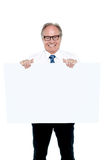 Senior marketing manager holding up a blank ad board Royalty Free Stock Image