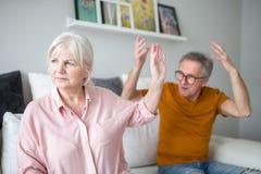 Senior marriage having argue at home. Portrait of senior marriage having argue at home stock photography