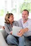 Senior married couple enjoying free time at home Stock Image