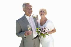 senior married couple on wedding day with champagne, cut out Stock Photos