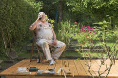 Senior master with beer royalty free stock image