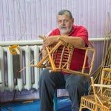 Senior master of wicker-work Stock Image