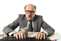 Senior mature busy business man with bald head on his 60s working stressed and frustrated at office computer laptop desk looking a. Senior mature busy business Royalty Free Stock Photos