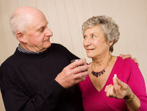 Senior mature couple taking pain medication Royalty Free Stock Photo