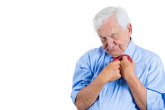 Senior mature, elderly man very nervous, stressed, anxious, thinking about something making him crazy while fumbling with his tie Stock Photography