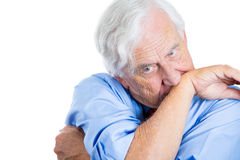 senior mature, elderly man very nervous, stressed, and thinking about something making him crazy Stock Image