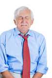 Senior mature, elderly man very sad and depressed and almost to the point of crying Royalty Free Stock Image