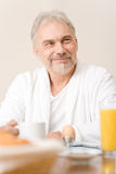 Senior mature man - breakfast at home Stock Photos