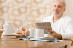 Senior mature man - breakfast at home Stock Images