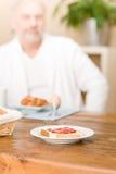 Senior mature man - breakfast at home Stock Photo