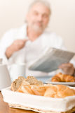 Senior mature man - breakfast pastry and bread Royalty Free Stock Photo