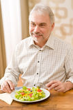 Senior mature man eat vegetable salad Stock Images