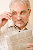 Senior mature man with glasses and newspaper Royalty Free Stock Images