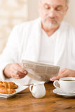 Senior mature man having breakfast Stock Image