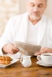 Senior mature man having breakfast Stock Image