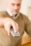 Senior mature man holding remote control Royalty Free Stock Photos