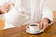 Senior mature man pour coffee wear bathrobe Royalty Free Stock Images