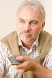 Senior mature man with remote control Stock Photo