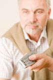 Senior mature man with remote control Stock Photos