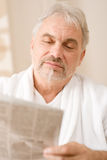 Senior mature man thoughtful read newspaper Royalty Free Stock Photo