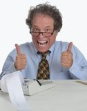 Senior mature man working on Financial Report. Older gentleman working on his possible retirement account with a happy successful look Royalty Free Stock Photo