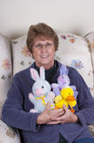 Senior Mature Woman Easter Bunny Stuffed Toys Royalty Free Stock Image