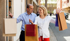 Senior with mature woman having shopping tour in city. Senior with mature women having shopping tour in city and smiling Stock Photo